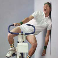 Man yawning while sitting on exercise bicycle --- Image by © Solus-Veer/Corbis